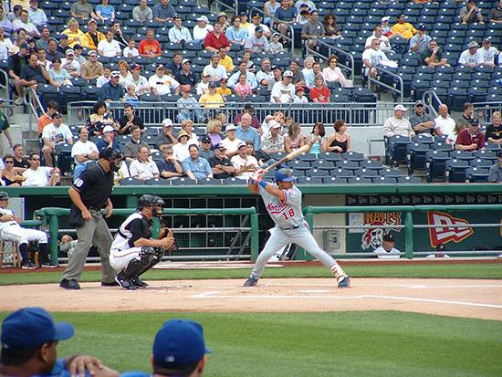 baseball fans sitting along third baseline at Expos-Pirates game
