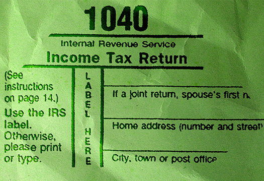 wrinkled paper photoshop texture green Kryptonite color overlaid with 1040 federal income tax form text