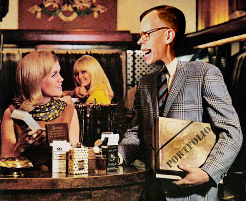 close-up of revised old magazine print ad for Playboy Magazine asking what sort of man reads Playboy with illustrator Mark Armstrong holding coffee-stained portfolio and getting admiring glances from two beautiful women