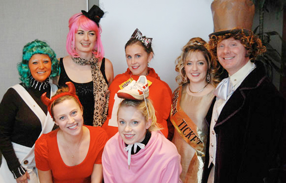 Employees at Rusty George Creative all wearing funny costumes for Halloween