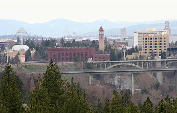 photo of Spokane, WA which I used to create Christmas cover for Inland Register, diocesan Catholic newspaper for Spokane, Washington, showing Spokane cityscape with Lampshade Christmas tree and manger scene under bridge