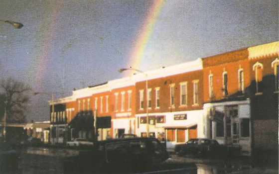 grainy old Polaroid photo showing rainbow arching onto walkup apartment in Tampico, Illinois where Ronald Reagan was born, taken by Lloyd McElhiney on November 3, 1980, day before Reagan was elected president