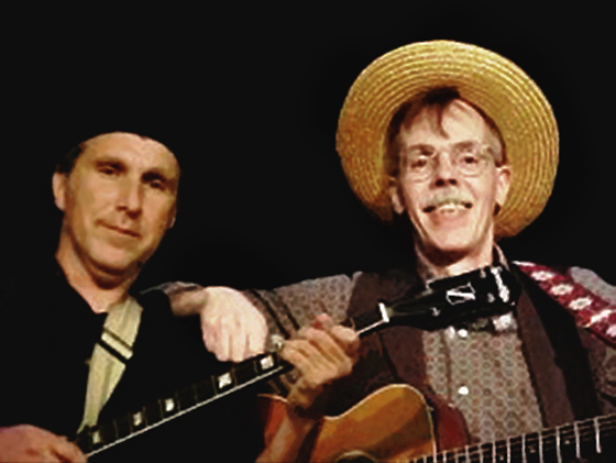 Michael Mike Cohen and Mark Armstrong guitar and banjo musicians for musical version of Spoon River Anthology presented by Branch River Theater in Marlborough New Hampshire