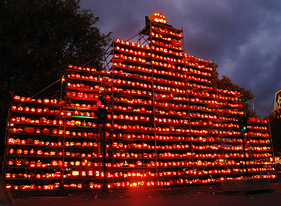 main tower keene new hampshire pumpkin festival showing hundreds of carved and lighted jack o'lanterns