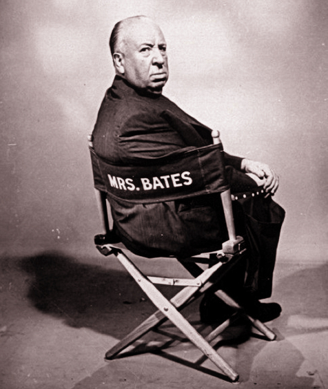 Alfred Hitchcock who directed horror movie thriller Psycho sitting in director's chair reserved for Norman's mother Mrs. Bates