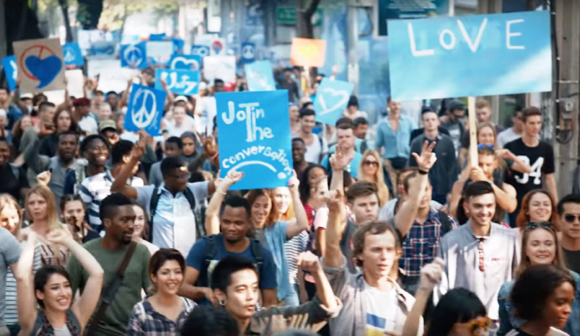 Kendall Jenner Pepsi ad generic happy protest marchers carrying bland signs peace love unity join the conversation