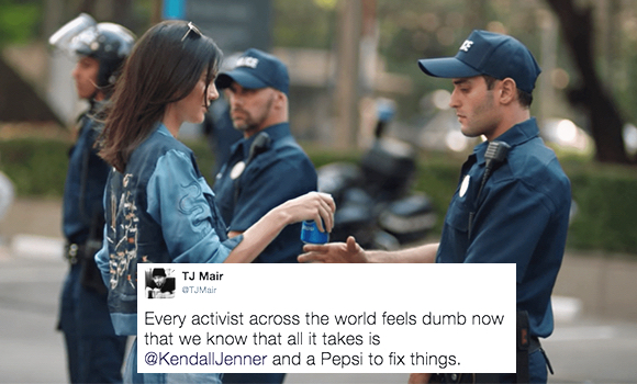 Kendall Jenner Pepsi protest marchers ad handing Pepsi to young cop derogatory tweet ridiculing gesture phoniness of ad itself