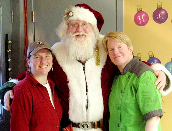 Deidre Pope Robyn Dochterman co-owners St. Croix Chocolate Company with jolly old Santa Claus