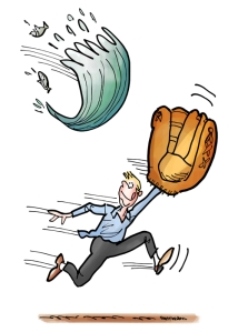 Young man with huge baseball glove running trying to catch a big wave of water that's flying through air with fish coming out of it